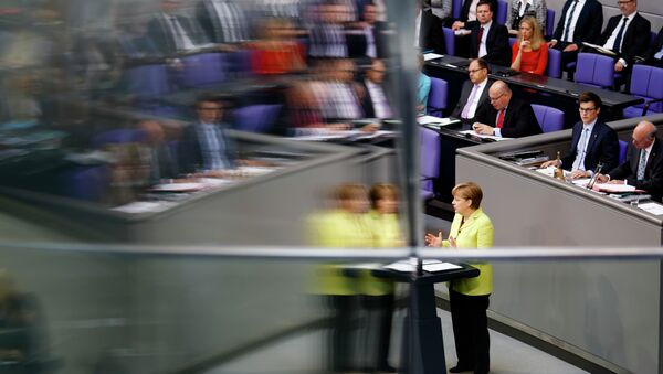Angela Merkel is reflected in a window pane as she delivers a government declaration about the European Union and an Eastern Partnership with former Soviet Republics at the German parliament Bundestag in Berlin, Germany, Thursday, May 21, 2015. - Sputnik France