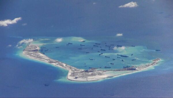 Chinese dredging vessels are purportedly seen in the waters around Mischief Reef in the disputed Spratly Islands, image from video taken by a P-8A Poseidon - Sputnik France