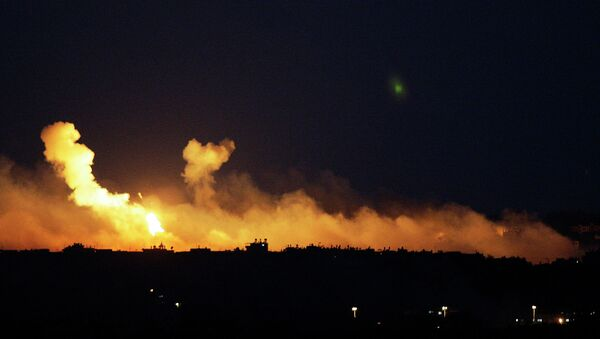 The sky is illuminated by explosions from Israeli military operations over the outskirts of Gaza City as seen from the Israel-Gaza Border. FILE PHOTO - Sputnik France