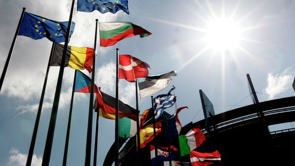Flags are seen at the European Parliament Wednesday April 16, 2014 in Strasbourg, eastern France. The European general elections in the 27 countries of the E.U will take place from May 22 to 25, 2014 - Sputnik France