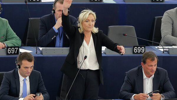 France's far-right National Front political party leader and member of the European Parliament Marine Le Pen (C) - Sputnik France