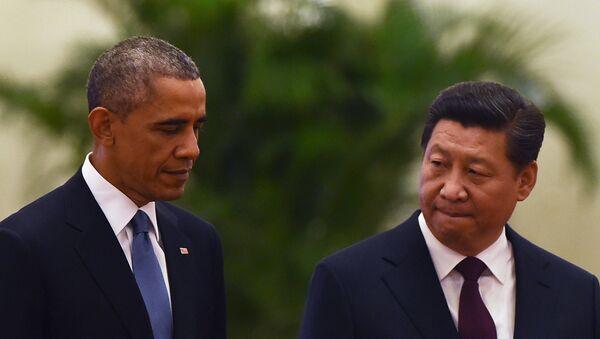 US President Barack Obama (L) walks with Chinese President Xi Jinping - Sputnik France