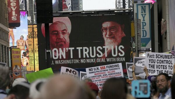 An image of Iranian leaders is projected on a giant screen in front of demonstrators during a rally apposing the nuclear deal with Iran in Times Square in the Manhattan borough of New York City - Sputnik France