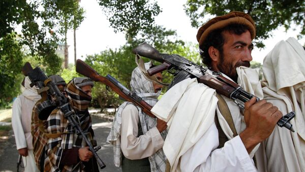 Taliban fighters hold their heavy and light weapons before surrendering them to Afghan authorities in Jalalabad, east of Kabul, Afghanistan. File photo - Sputnik France