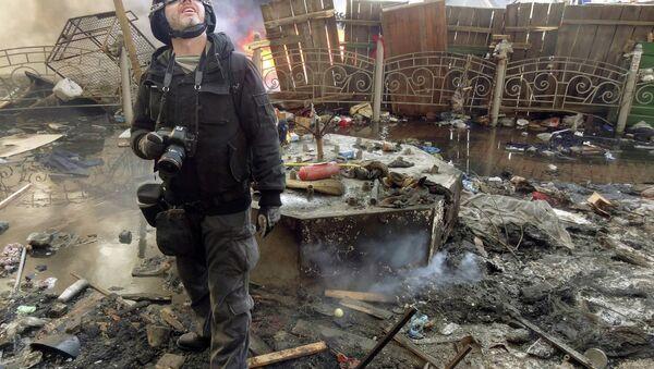 Undated file picture taken in Kiev shows Andrei Stenin, a photographer working for Russian RIA Novosti press agency - Sputnik France