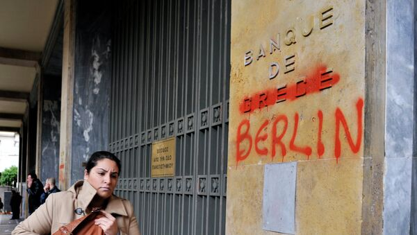 A woman passes by the Bank of Greece headquarters where 'Greece' was changed to 'Berlin' during a 24-hour general strike in Athens on February 7, 2012. - Sputnik France