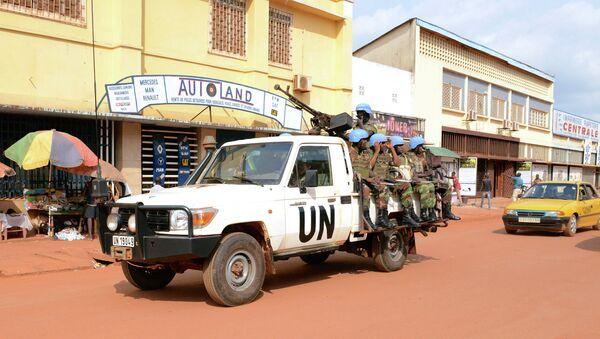 UN peacekeeping soldiers from Rwanda patrol on December 09, 2014 in Bangui - Sputnik France