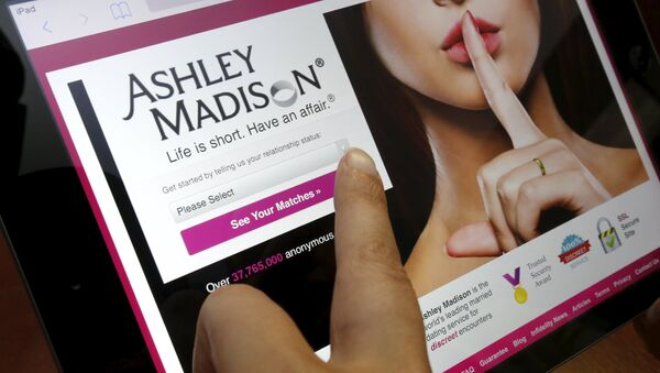 The homepage of the Ashley Madison website is displayed on an iPad, in this photo illustration taken in Ottawa, Canada July 21, 2015 - Sputnik France