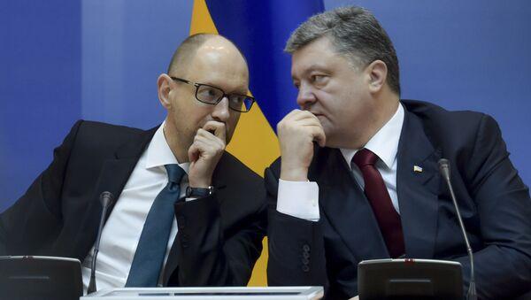 Le premier ministre ukrainien Arseni Iatseniouk et le président ukrainien Piotr Porochenko - Sputnik France