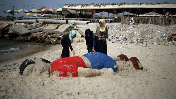 Sculpture de sable représentant le garçon syrien Aylan Kurdi, Gaza - Sputnik France