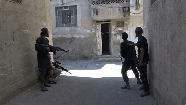 Des combattants du groupe terroriste Etat islamique en Syrie - Sputnik France