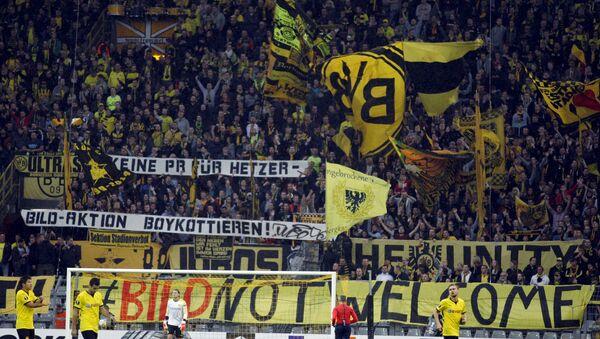 Borussia Dortmund fans hold up banners 'Bild not welcome' during their Europa League group C soccer match against FC Krasnodar in Dortmund, Germany September 17, 2015. - Sputnik France