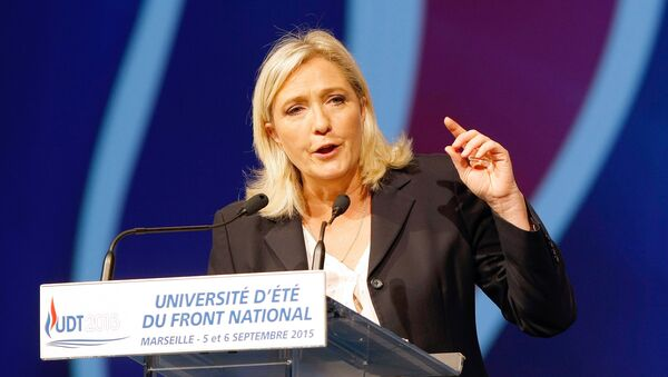 President of France's far right National Front party Marine Le Pen, delivers her speech during their summer meeting, in Marseille, southern France, Saturday, Sep. 6, 2015 - Sputnik France