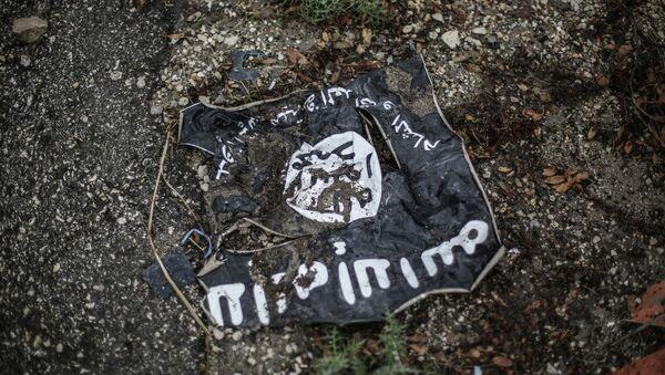 The flag of the radical Islamist organization Islamic State of Iraq - Sputnik France