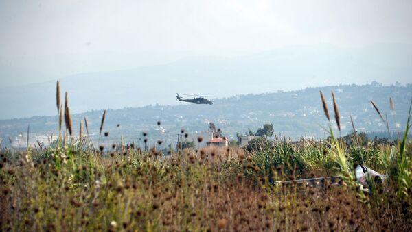 Российский вертолет Ми-24 патрулирует окрестности авиабазы Хмеймим - Sputnik France