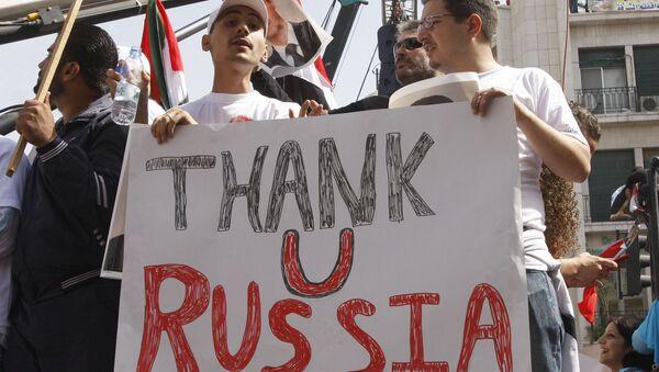 Des Syriens disant merci à la Russie, Damas, Syrie - Sputnik France