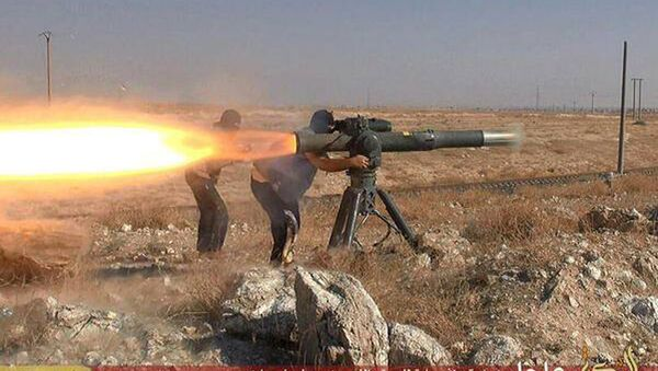 In this picture released on June 26, 2015, by a website of Islamic State militants, Islamic State militants fire an anti-tank missile in Hassakeh, northeast Syria - Sputnik France