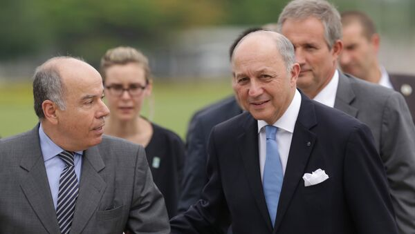 French Foreign Minister Laurent Fabius, right, talks with his Brazilian counterpart Mauro Vieira, during his arrival to meet with Brazil's President Dilma Rousseff, at the Alvorada Palace, in Brasilia, Brazil, Sunday, Nov. 22, 2015. - Sputnik France