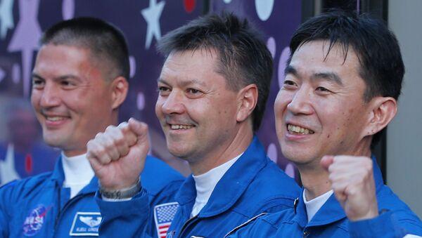 Le cosmonaute russe Oleg Kononenko et les astronautes  américain Kjell Norwood Lindgren et japonais Kimiya Yui - Sputnik France