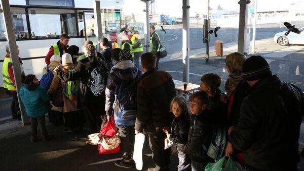 migrants syriens et irakiens à destination de la Suède - Sputnik France
