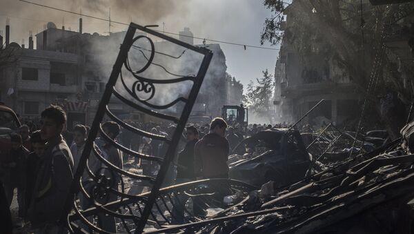 résidents de Homs, site de l'attentat terroriste dans le centre-ville - Sputnik France