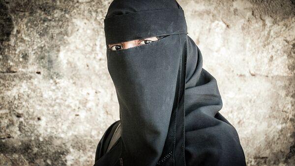 Une femme portant le niqab - Sputnik France