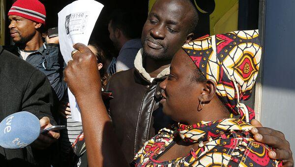 Un réfugié sénégalais gagne 400.000 euros à la loterie espagnole - Sputnik France