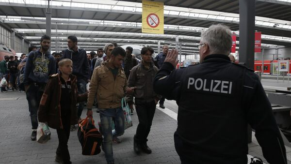 Polizei und Flüchtlinge auf dem Hauptbahnhof in München - Sputnik France