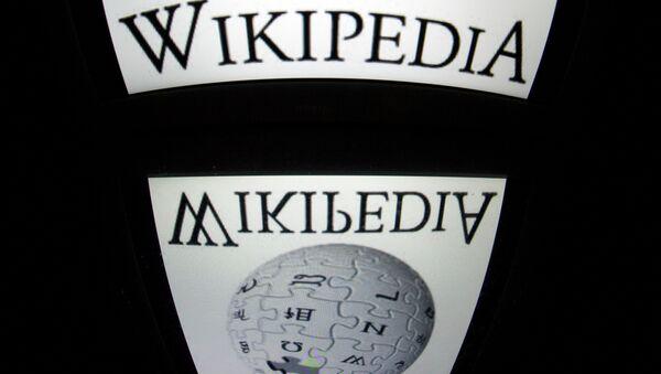 The Wikipedia logo is seen on a tablet screen on December 4, 2012 in Paris - Sputnik France