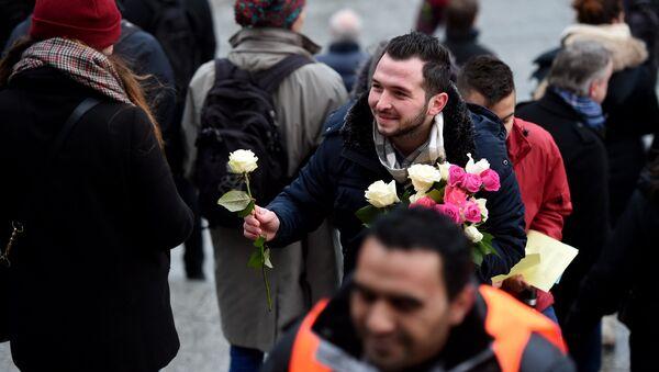 Allemagne: des roses contre la barbarie - Sputnik France
