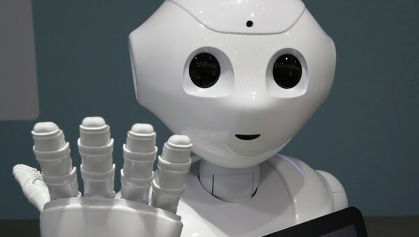 In this June 6, 2014 file photo, humanoid robot Pepper is on display at SoftBank mobile shop in Tokyo. Japanese mobile carrier Softbank said Tuesday, Feb. 10, 2015 it will incorporate artificial intelligence technology from IBM into its empathetic robot Pepper that goes on sale in Japan this month. - Sputnik France
