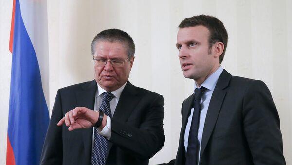 Alexeï Oulioukaïev et Emmanuel Macron - Sputnik France