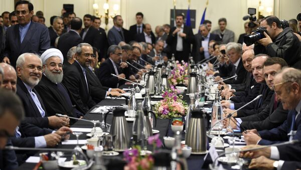 Iranian President Hassan Rouhani (3rd-L) and Iranian Foreign Minister Mohammad Javad Zarif (2nd-L) attend a meeting with French Economy Minister Emmanuel Macron (2nd-R), Movement of the Enterprises of France (MEDEF) president Pierre Gattaz (3rd-R) and French Foreign Minister Laurent Fabius (4th-R) in Paris on January 27, 2016. Rouhani arrived in France from Italy on the second leg of a trip signalling the dramatic rapprochement between Tehran and the European powers since the lifting of sanctions against the Islamic Republic. - Sputnik France