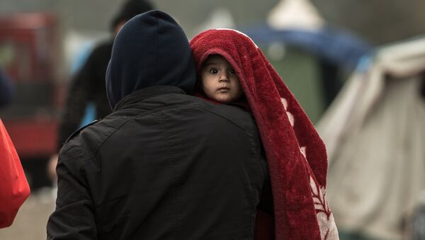 Migrants dans un camp. - Sputnik France