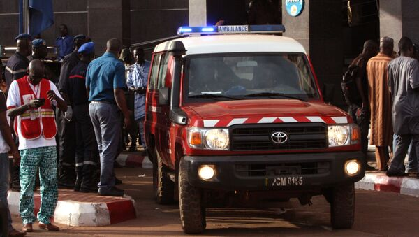 An ambulance seen outside the Radisson Blu hotel, after an attack by gunmen on the hotel, in Bamako, Mali, Friday, Nov. 20, 2015. Islamic extremists armed with guns and grenades stormed the luxury Radisson Blu hotel in Mali's capital Friday morning, and security forces worked to free guests floor by floor. - Sputnik France