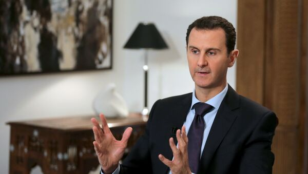Syrian President Bashar al-Assad gestures during an exclusive interview with AFP in the capital Damascus on February 11, 2016. - Sputnik France