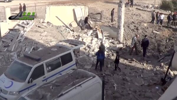 People gather near what is said to be a hospital damaged by missile attacks in Azaz, Aleppo, Syria, February 15, 2016 in this still image taken from a video on a social media website. - Sputnik France