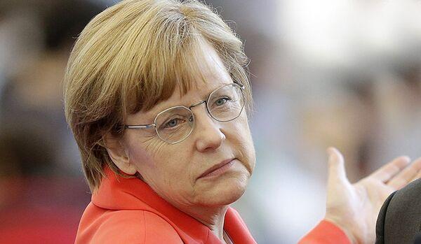 Porochenko a invité Merkel à se rendre en Ukraine - Sputnik France