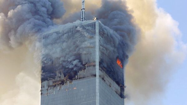 Fire and smoke billows from the north tower of New York's World Trade Center Tuesday Sept. 11, 2001 after terrorists crashed two hijacked airliners into the World Trade Center and brought down the twin 110-story towers. - Sputnik France