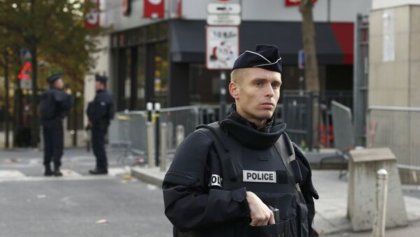 Police take up position near the Stade de France stadium the morning after a series of deadly attacks in Paris , November 14, 2015. - Sputnik France