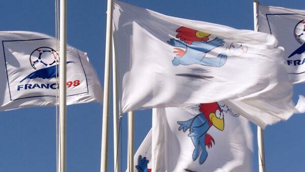 Flags with the France 98 logo and Footix, the mascot of the France 98 World Cup, flutter in strong breeze 12 June at the Velodrome Stadium in Marseille before the 1998 Soccer World Cup Group C first round match between France and South Africa. - Sputnik France
