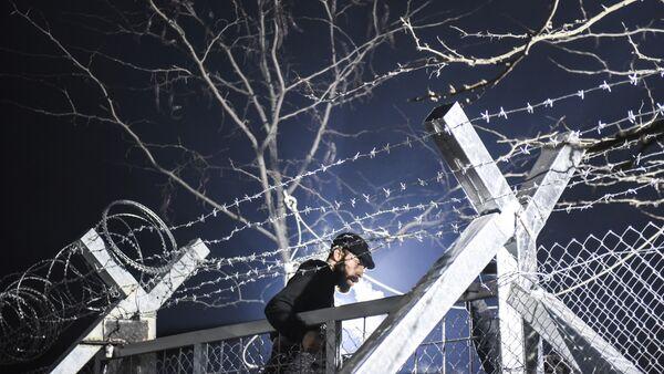 Un migrant - Sputnik France