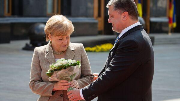 La chancelière allemande Angela Merkel et le président ukrainien Piotr Porochenko - Sputnik France