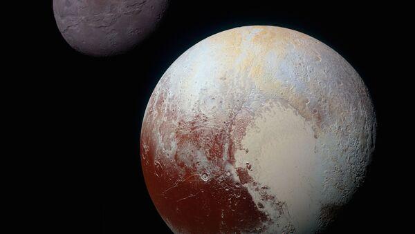 Цветные изображения Плутона его крупнейшего спутника Харона - Sputnik France