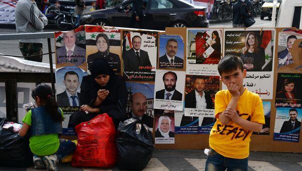 Предвыборные плакаты кандидатов в парламент Сирии - Sputnik France