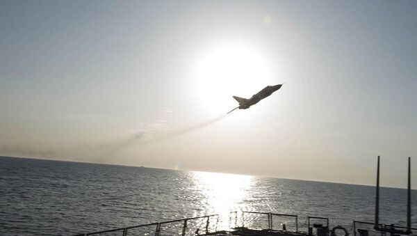 An U.S. Navy picture shows what appears to be a Russian Sukhoi SU-24 attack aircraft flying over the U.S. guided missile destroyer USS Donald Cook in the Baltic Sea in this picture taken April 12, 2016 and released April 13, 2016 - Sputnik France