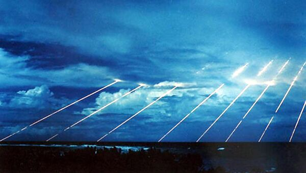 An undated recent US Army file picture shows US Peacekeeper (MX) missile tests streaking across the sky enroute to targets in and around Kwajalein Atoll, in the Marshall Islands. - Sputnik France