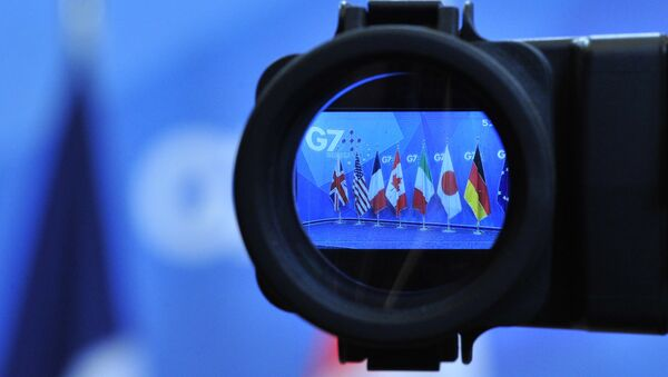 Flags are seen in a camera screen at the G7 summit (file) - Sputnik France