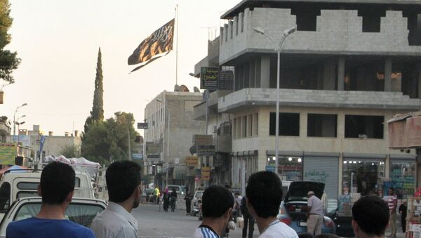 A group of men look at a large black Jihadist flag with Islamic writing on it proclaiming in Arabic that There is no God but God and Mohammed is the prophet of God, as they look over towards a building in the northern rebel-held Syrian city of Raqqa on September 28, 2013. - Sputnik France