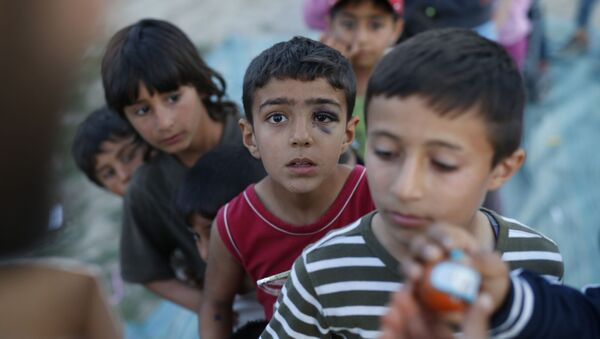 Enfants réfugiés - Sputnik France